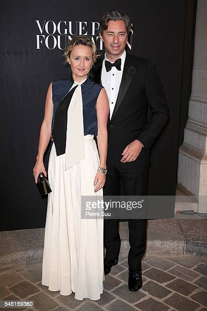 Caroline Roux and Laurent Solly attend the Vogue Foundation Gala 2016 at Palais Galliera on July 5 2016 in Paris France