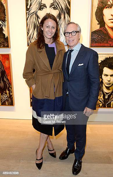 Caroline Rush and Tommy Hilfiger attend a private view of Rock Style a new exhibition curated by Tommy Hilfiger and Jeffrey Deitch at Sotheby's on...