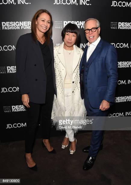 Caroline Rush, Angelica Cheung and Tommy Hilfiger attend the BFC Vogue Fashion Fund and JD.COM cocktail party hosted by Caroline Rush and Xia Ding at...