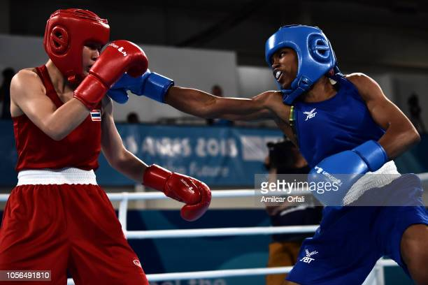 Caroline Sara Dubois of Great Britain beats Porntip Buapa of Thailand in Women's Light during day 12 of Buenos Aires 2018 Youth Olympic Games at...