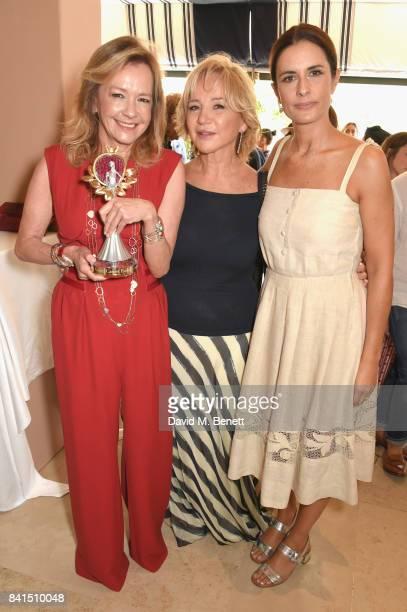 Caroline Scheufele Alberta Ferretti and Livia Firth attend an intimate lunch hosted by Livia Firth Carlo Capasa and Caroline Scheufele to announce...