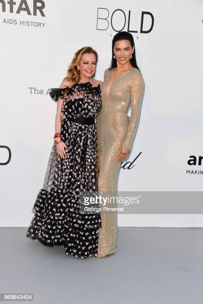 Caroline Scheufele and Adriana Lima arrive at the amfAR Gala Cannes 2018 at Hotel du CapEdenRoc on May 17 2018 in Cap d'Antibes France