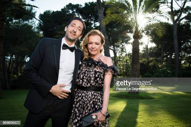 Caroline Scheufele and Adrien Brody pose for portraits at the amfAR Gala Cannes 2018 cocktail at Hotel du CapEdenRoc on May 17 2018 in Cap d'Antibes...