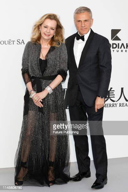Caroline Scheufele and Christoph Waltz at the amfAR Cannes Gala 2019 at Hotel du CapEdenRoc on May 23 2019 in Cap d'Antibes France