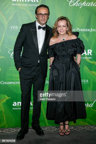 Caroline Scheufele and guest attends the amfAR Paris Dinner 2018 at The Peninsula Hotel on July 4 2018 in Paris France