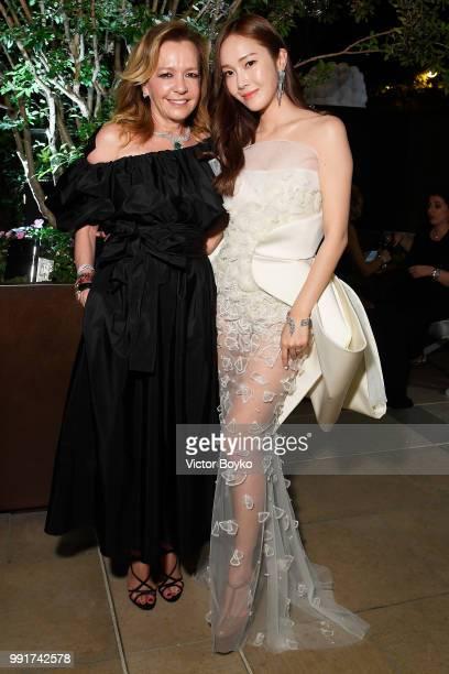 Caroline Scheufele and Jessica Jung attend amfAR Paris Dinner 2018 at The Peninsula Hotel on July 4 2018 in Paris France