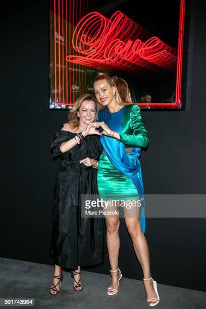 Caroline Scheufele and model Petra Nemcova attend the amfAR Paris Dinner 2018 at The Peninsula Hotel on July 4 2018 in Paris France
