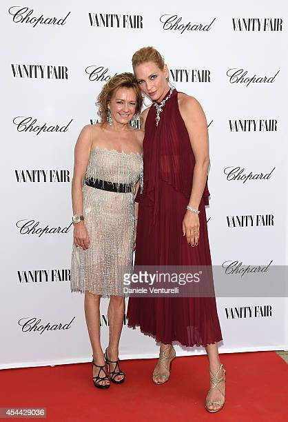Caroline Scheufele and Uma Thurman attend the Chopard And Vanity Fair Present 'Backstage At Cinecitta' Exhibition Red Carpet 71st Venice Film...