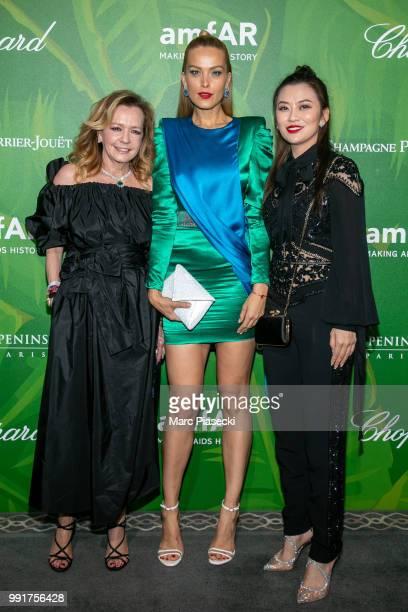 Caroline Scheufele model Petra Nemcova and a guest attend the amfAR Paris Dinner 2018 at The Peninsula Hotel on July 4 2018 in Paris France
