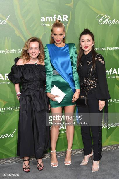 R Caroline Scheufele model Petra Nemcova and a guest attend the amfAR Paris Dinner 2018 at The Peninsula Hotel on July 4 2018 in Paris France