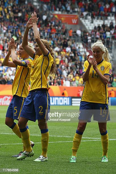 Caroline Seger Charlotte Rohlin and Josefine Oqvist of Sweden celebrate the 10 victory after the FIFA Women's World Cup 2011 Group C match between...