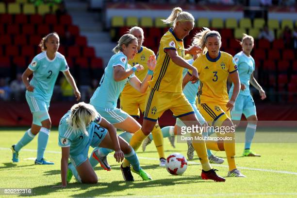 Caroline Seger of Sweden and Elena Morozova of Russia compete for the ball during the Group B match between Sweden and Russia during the UEFA Women's...