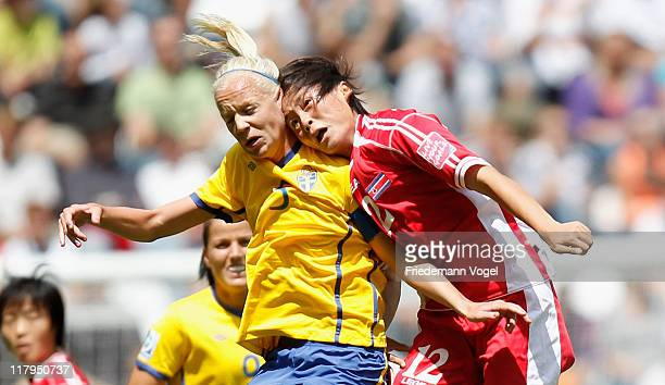 Caroline Seger of Sweden and Myong Hwa Jon of Korea battle for the ball during the FIFA Women's World Cup 2011 Group C match between North Korea and...