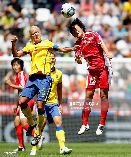 Caroline Seger of Sweden and Myong Hwa Jon of Korea jump for a header during the FIFA Women's World Cup 2011 Group C match between North Korea and...