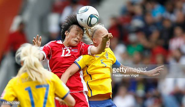 Caroline Seger of Sweden and Myong Hwa Jon the ball during the FIFA Women's World Cup 2011 Group C match between North Korea and Sweden at FIFA World...