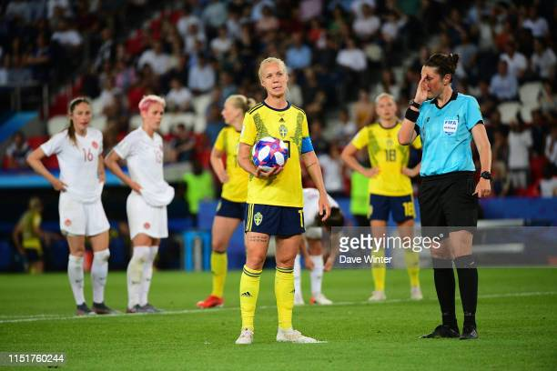 Caroline Seger of Sweden awaits to take a penalty, but VAR over rules referee Kate Jacewicz during the 2019 FIFA Women's World Cup Round of 16 match...