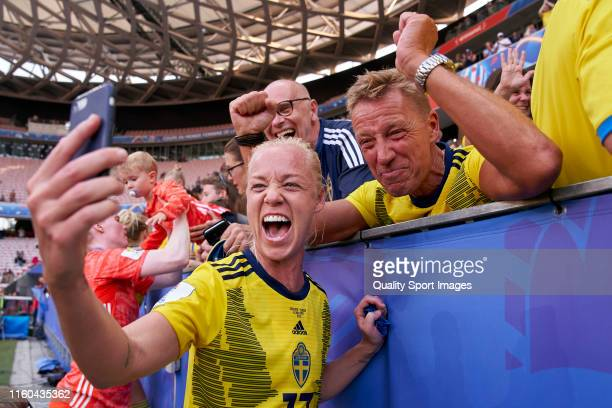 Caroline Seger of Sweden celebrates third places after the match with relatives and friends during the 2019 FIFA Women's World Cup France 3rd Place...
