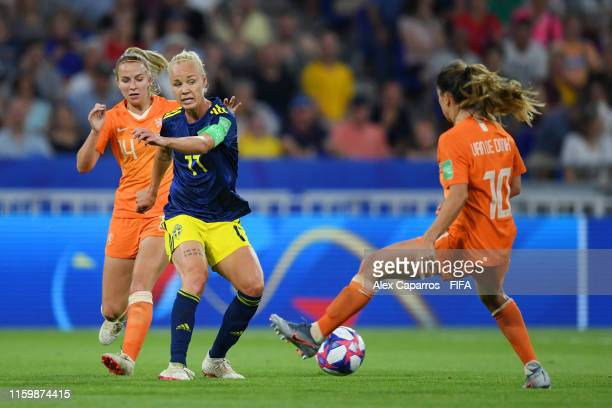 Caroline Seger of Sweden looks to shoot past Danielle Van De Donk of the Netherlands during the 2019 FIFA Women's World Cup France Semi Final match...