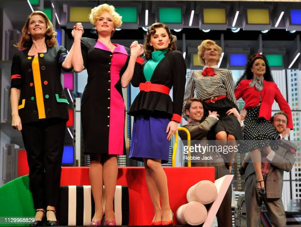 Caroline Sheen as Violet Newstead Natalie McQueen as Doralee Rhodes and Amber Davies as Judy Bernly with artists of the company in 9 To 5 The Musical...