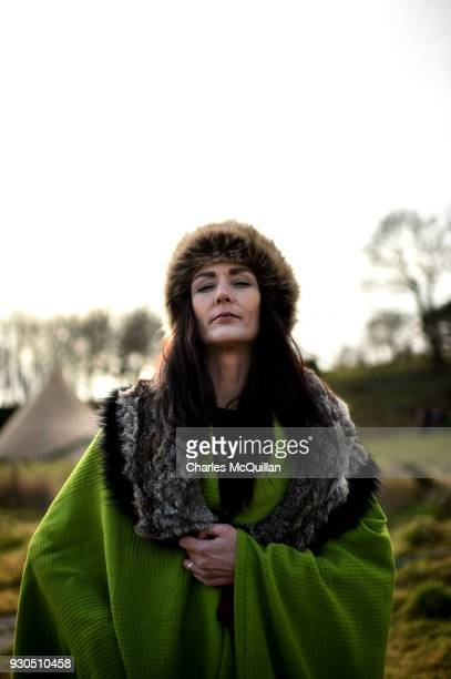 Caroline Sheerin a member of the Magnus Viking association poses for a photograph as she takes part in the reenactment of Saint Patrick's first...