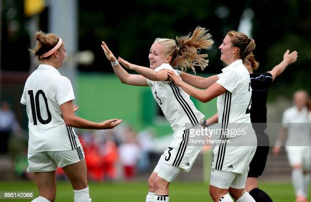 Caroline Siems of Germany celebrates after scoring her team's third goal with Laura Freigang and Dina Orschmann of Germany during the U19 women's...