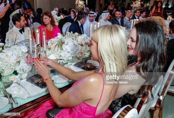 Caroline Stanbury and Madeleine Stowe attend the Artists for Peace and Justice Bovet 1822 Gala on December 7 2018 in Dubai United Arab Emirates Photo...