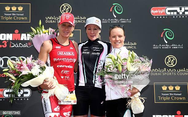 Caroline Steffen of Switrzerland Daniela Ryf of Switzerland and Kaisa Lehtonen of Finland pose on the podium after the IRONMAN 703 Dubai on January...