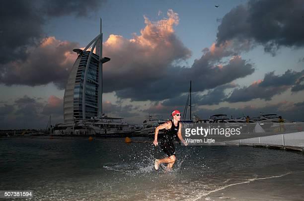 Caroline Steffen of Switrzerland leaves the sea after the swim during the Women's IRONMAN 703 Dubai on January 29 2016 in Dubai United Arab Emirates