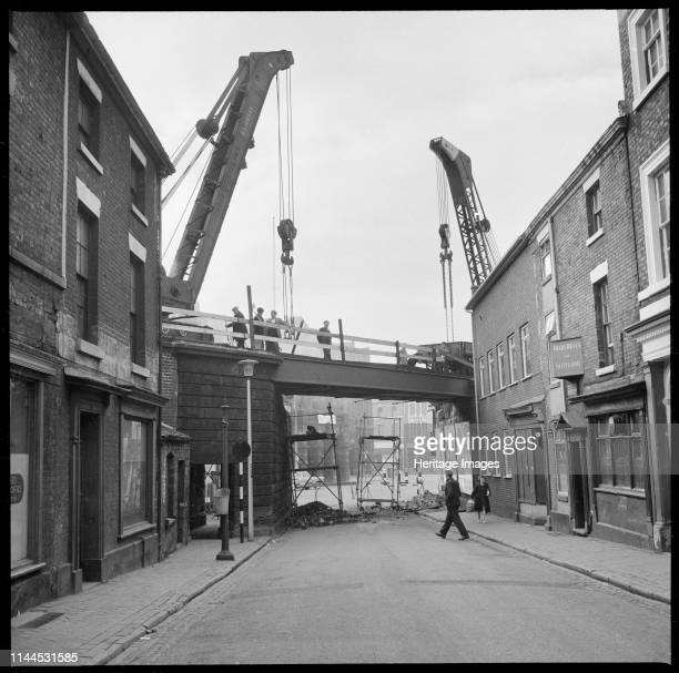Caroline Street Longton StokeonTrent 19651968 A view looking west along Caroline Street showing repair work being carried out on the bridge carrying...