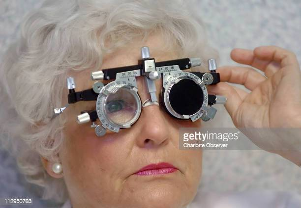 Caroline Tate wears special glasses as she takes an eye vision test before getting an injection of Lucentis to treat macular degeneration at...