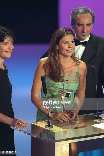 Caroline Tresca and Patrick Mahe director of Tele 7 Jours present a 7 d'or to Veronika Loubry