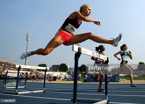 Caroline Vaughn clears a barrier in a girls' 400-meter hurdle heat in the Nike Outdoor Nationals at North Carollina A&T's Aggie Stadium in...