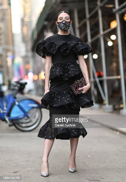 Caroline Vazzana is seen wearing a black Christian Siriano dress outside the Christian Siriano show during New York Fashion Week F/W21 on February...