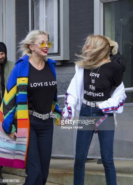 Caroline Vreeland and Shea Marie are seen at Spring Studios outside the Phillip Lim show Caroline wears black cotton protest tshirt with 'love is...
