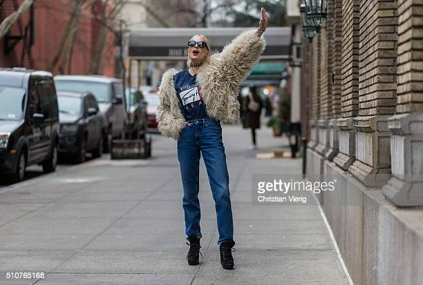 Caroline Vreeland wearing a beige fur jacket and a blue Tommy Hilfiger shirt and blue denim jeans seen outside Tommy Hilfiger during New York Fashion...