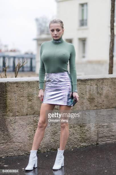 Caroline Vreeland wearing a tight longshirt silver mini skirt outside Mugler on March 4 2017 in Paris France
