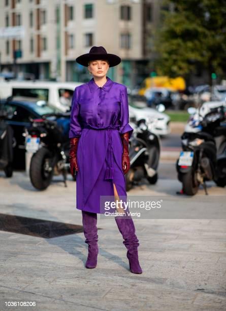 Caroline Vreeland wearing purple dress boots and hat seen outside Alberta Ferretti during Milan Fashion Week Spring/Summer 2019 on September 19 2018...