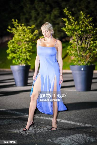 Caroline Vreeland wears a blue dress, heels shoes, earrings, outside Jacquemus, during Paris Fashion Week Womenswear Fall/Winter 2019/2020, on...