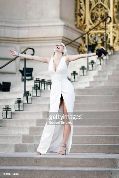 Caroline Vreeland wears a white dress outside the amfAR dinner at Petit Palais during Paris Fashion Week Haute Couture Fall/Winter 20172018 on July 2...