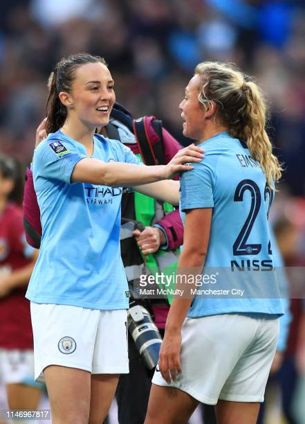 Caroline Weir and Claire Emslie of Manchester City Women celebrate following their team's victory in the Women's FA Cup Final match between...