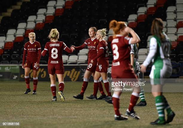 Caroline Weir Laura Coombs and Ashley Hodson of Liverpool Ladies celebrate after AnnMarie Heatherson of Yeovil Town Ladies scored an own goal during...