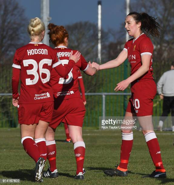 Caroline Weir of Liverpool Ladies celebrates scoring the second goal of the game with team mates Ashley Hodson and Martha Harris during the SSE...