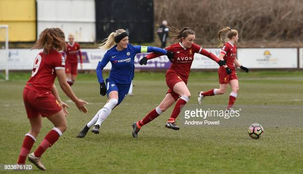 Caroline Weir of Liverpool Ladies competes with Katie Chapman of Chelsea Ladies during the SSE Women's FA Cup Quarter Final match between Liverpool...