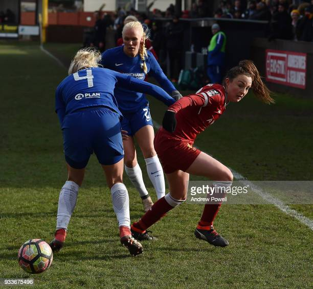 Caroline Weir of Liverpool Ladies competes with Millie Bright of Chelsea Ladies during the SSE Women's FA Cup Quarter Final match between Liverpool...