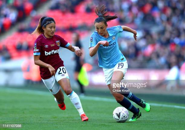 Caroline Weir of Manchester City and Cho So Hyun of West Ham Women in action during the Women's FA Cup Final match between Manchester City Women and...