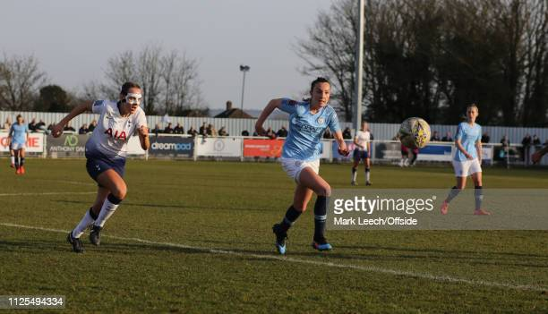 Caroline Weir of Manchester City and Josie Green of Tottenham wearing a protective face mask in a race for the ball during the SSE Women's FA Cup...