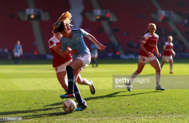 Caroline Weir of Manchester City and Leah Williamson of Arsenal in action during the Continental League Cup Final between Arsenal Women and...