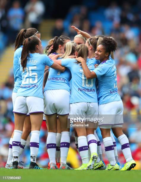 Caroline Weir of Manchester City celebrates after scoring her team's first goal with Demi Stokes and team mates during the Barclays FA Women's Super...