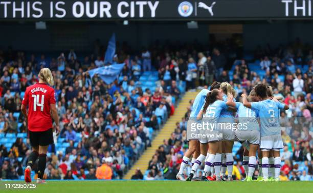 Caroline Weir of Manchester City celebrates after scoring her team's first goal with team mates during the Barclays FA Women's Super League match...