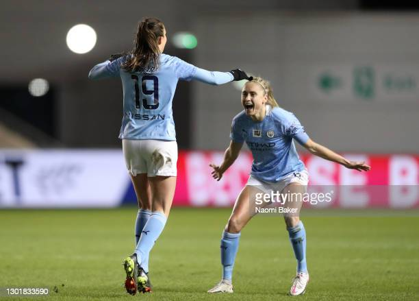 Caroline Weir of Manchester City celebrates scoring her sides third goal with Steph Houghton of Manchester City during the Barclays FA Women's Super...